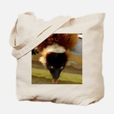 A Red Ruffed Lemurs drinking Tote Bag