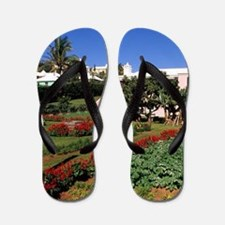 Pastel architecture and colorful garden Flip Flops