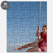Girl on rope swing, Oakura Bay, Northland,  Puzzle