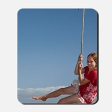 Girl on rope swing, Oakura Bay, Northlan Mousepad