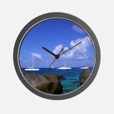 Boulder rocks and boats in the choppy w Wall Clock