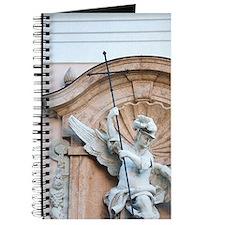 Marble relief sculpture on building facade Journal