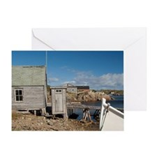 Cabin with outhouse in scenic harbor Greeting Card