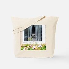 Zak in the windowA Tote Bag