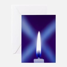 Burning candle with star burst on bl Greeting Card