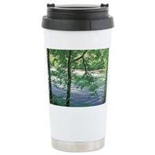 Trees and ferns on bank of rive Travel Mug