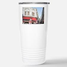 Shoppers crowd the sidewalks of Travel Mug