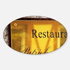 A brass sign outside the restaurant Decal
