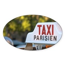 Sign atop a taxi in Paris, France. Decal
