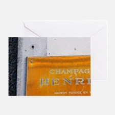 A polished brass sign: Champagne Hen Greeting Card