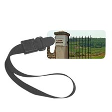 An iron gate to the vineyard Clo Luggage Tag