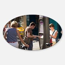 People using a Velib muni-meter to  Sticker (Oval)