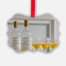 A glass golden yellow of Chateau  Ornament