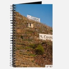 Signs saying Cote Rotie E Guigal M Chapotu Journal