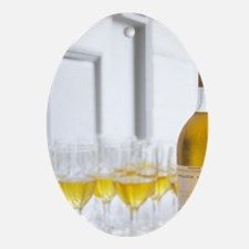 A glass golden yellow of Chateau de  Oval Ornament