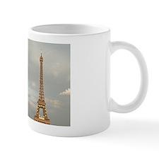 Tourists enjoy a view of the Eiffel Tow Mug