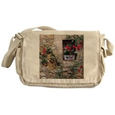 Flowers decorate a rock wall in Lour Messenger Bag
