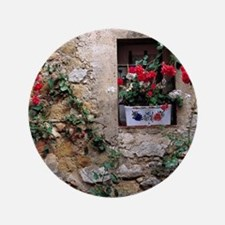 "Flowers decorate a rock wall in Lourma 3.5"" Button"