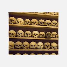 Meteora. Skulls of monastics on shel Throw Blanket