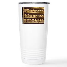 Meteora. Skulls of monastics on Travel Mug