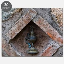 Meteora. Oil lamp embedded in stone wall at Puzzle