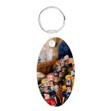 Wooden dolls in traditional Aluminum Oval Keychain