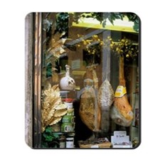 A store window display showing meats and Mousepad