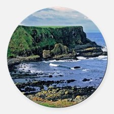 The rugged coastline is shaped by Round Car Magnet