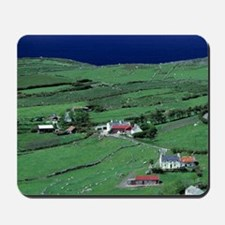 Whitewashed homes dot the green landscap Mousepad