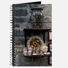 Europe, Italy, Umbria, Assisi. Pottery on  Journal