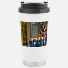 Display of blue jeans outside a Travel Mug