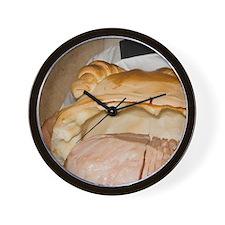 Cento. Waiter presents a ham prepared i Wall Clock