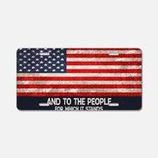 people-stands-OV Aluminum License Plate
