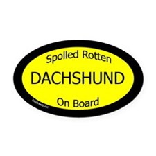 DachshundSpoiledRottenOnBoard Oval Car Magnet