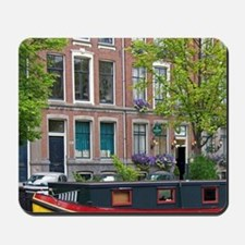 Canal boat docked in front of row houses Mousepad