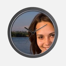 Female portrait in front of the river i Wall Clock