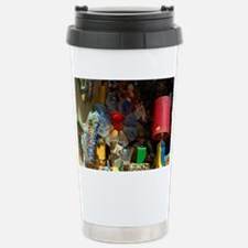 Store window display with typic Travel Mug