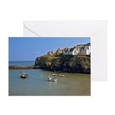 Isaac. Fishing boats sit calmly in t Greeting Card