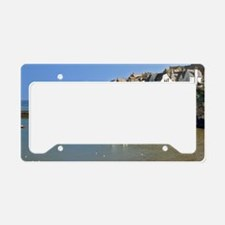 Isaac. Fishing boats sit calm License Plate Holder