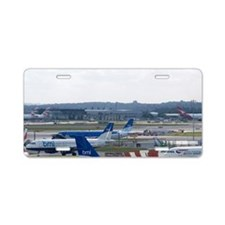 Airliners on the runway at  Aluminum License Plate