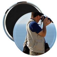 Photographer on hillside above city side ab Magnet