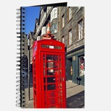 A bright red telephone booth stands out on Journal