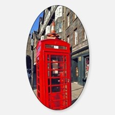 A bright red telephone booth stands Decal