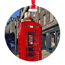 A bright red telephone booth stands Ornament