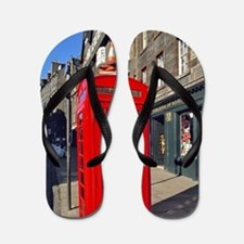 A bright red telephone booth stands out Flip Flops