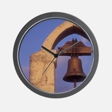 A lone bell hangs in the bell tower of  Wall Clock