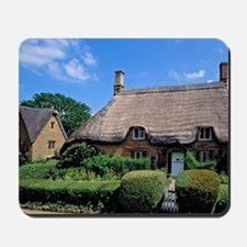 Is filled with thatched-roofed cottages  Mousepad