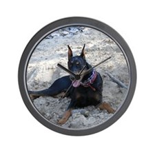 Paint dog in sand Wall Clock