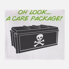 carepackage_on black Throw Blanket