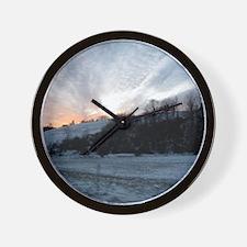 Sunset on Snowy Hills Wall Clock